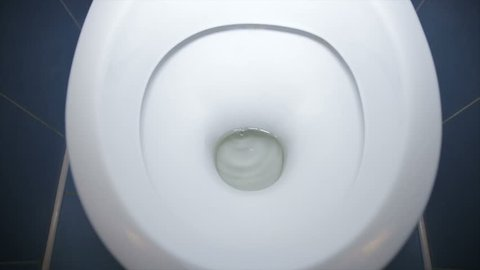 Toilet bowl with running water.full hd video