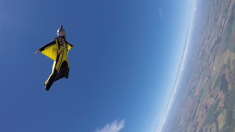 Skydiving wing suit woman acrobatic