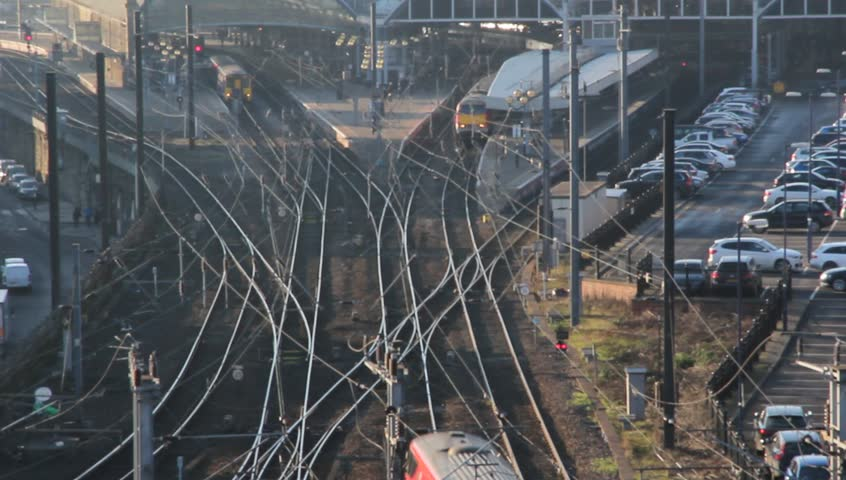 Newcastle Central station on East Coast Main line (ECML) showing one intercity train arrive while another starts to leave. The trains are headed to or from London and Edinburgh