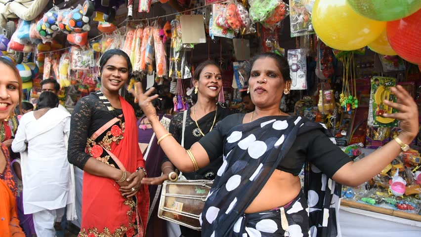 AMRAVATI, MAHARASHTRA, INDIA 22 JANUARY 2017 : Unidentified group hijra or transgenders dance and singing at street, It is a social category in the Indian society who recognizes third genders.