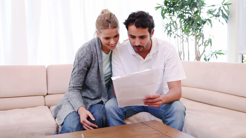 Smiling Couple Reading a Letter Stock Footage Video (100% Royalty