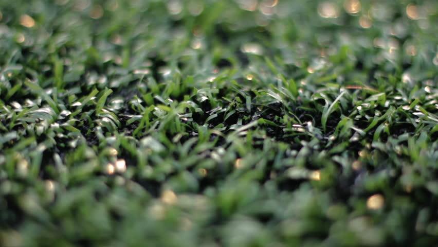 Macro close up of a turf football field.