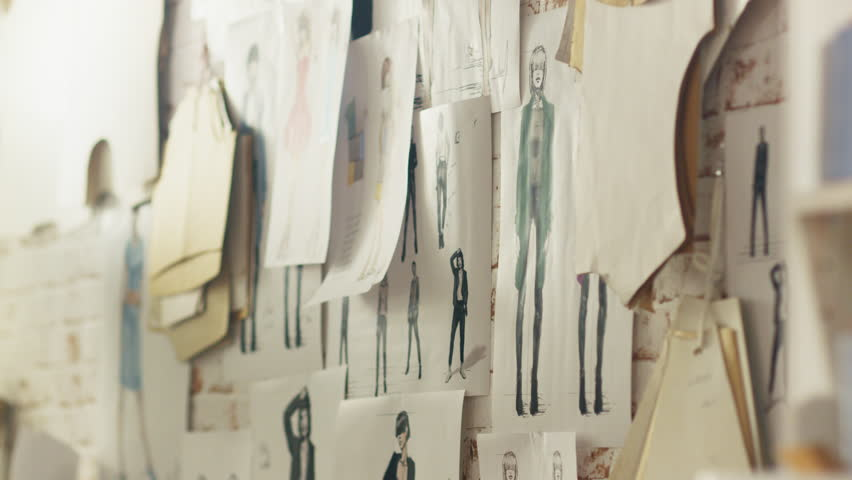 Zoom In On a Wall with Pinned Fashion Drawings and Sketches, Templates Hanging on the Wall. Shot on RED EPIC 4K (UHD).