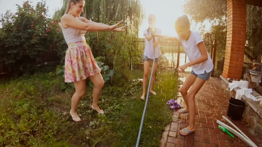 teen-girl-water-hose