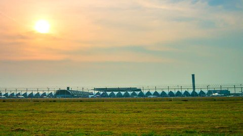 Plane landing and takeoff on runway at Suvarnabhumi International Airport