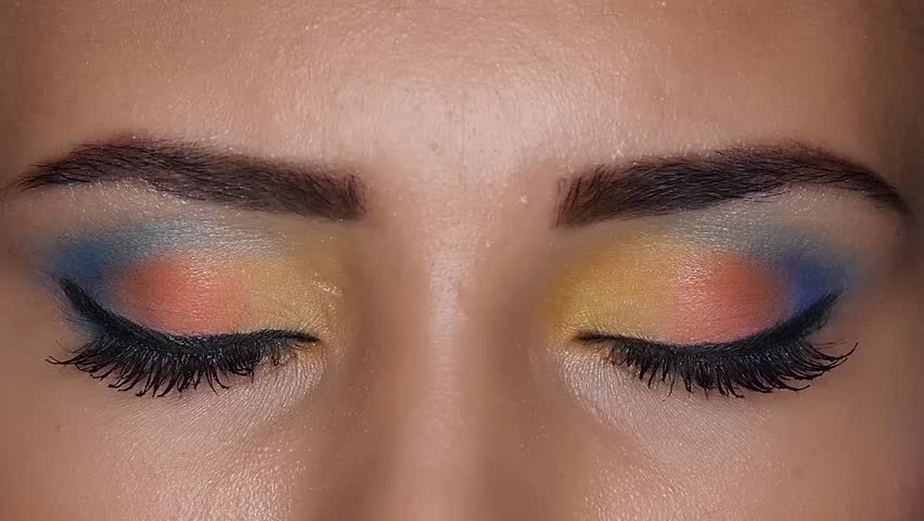 Girl shows beautiful bright make up that made her visagiste . Close up. Slow motion