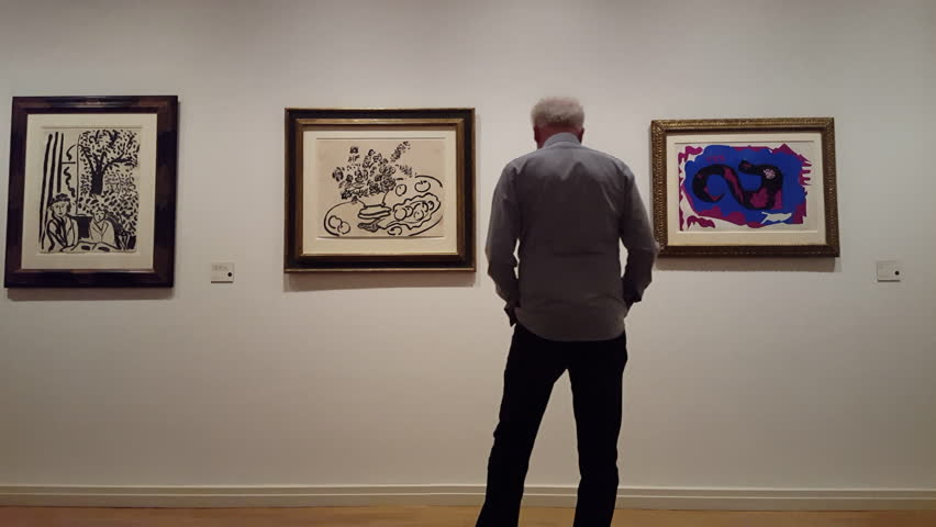 GERMANY - CIRCA MARCH 2016 - Old man admires art at museum gallery, Berlin, Germany