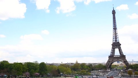 Paris panoramic view with the Eiffel Tower as main subject. Hand held video with pan righ movement of the most famous monument in Paris