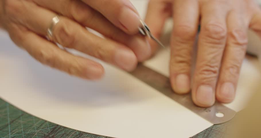 Slow motion close up shot of a man cutting shoe shape | Shutterstock HD Video #23490451