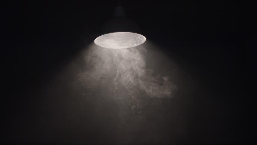 4K Hanging Swaying lamp on dark room. Shot on RED Cinema Camera in slow motion.