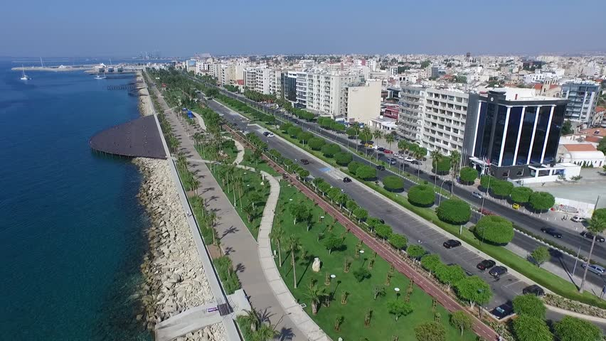 Aerial video of beachfront with parks and jetties in urban city of Limassol Cyprus