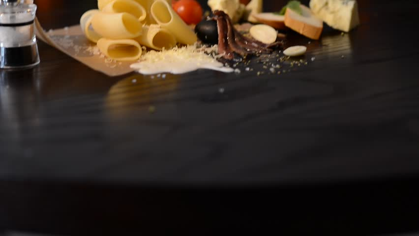 Food ingredients for italian pasta on black background stock food ingredients for italian pasta on black background hd stock video clip forumfinder Choice Image