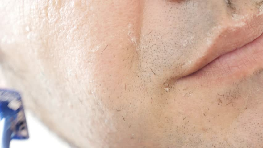 Modern man uses  disposable razor for shaving 4K 2160p 30fps UltraHD footage - Male hand  shaves beard on a chin close-up 3840X2160 UHD video   Shutterstock HD Video #23511961