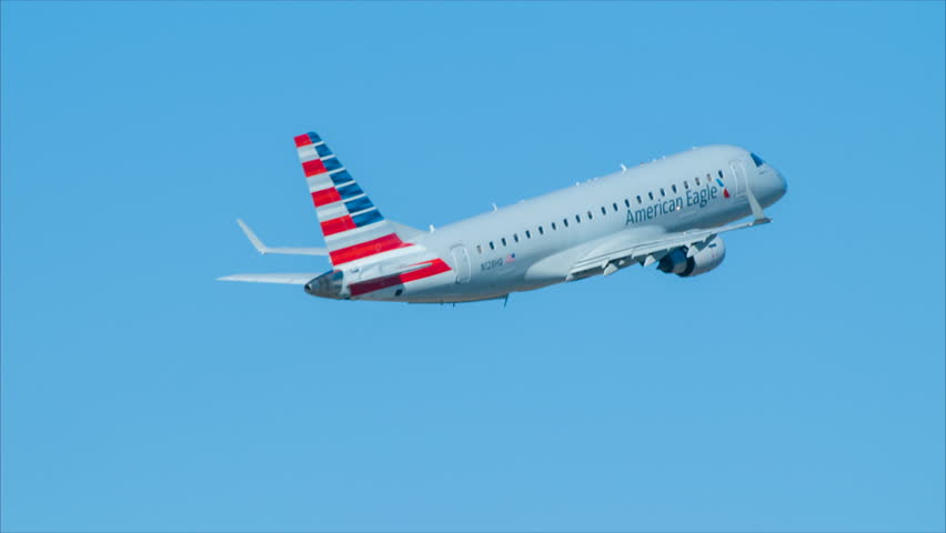 RALEIGH, NC - 2017: American Airlines Embraer ERJ 170 Jet Airliner Taking-off from Raleigh Durham International Airport RDU Close-up into a Blue Sky on a Sunny Day in North Carolina