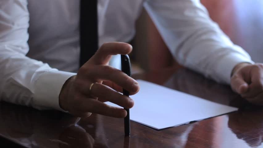Business man, a man writes with a ballpoint pen   Shutterstock HD Video #23582077