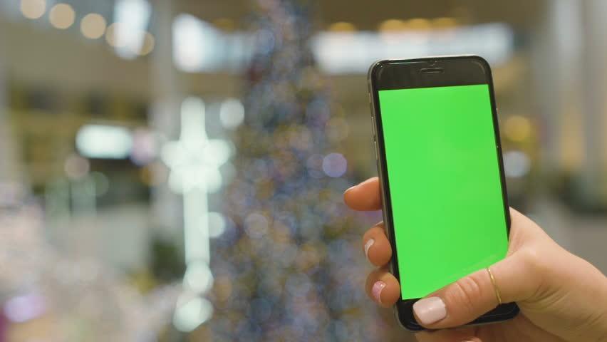 Woman at Supermarket Using Smartphone with green vertical screen. Closeup. HD, 1920x1080. | Shutterstock HD Video #23597791