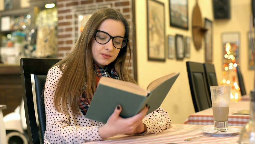 Girl finish reading book because of painful headache, steadycam shot  | Shutterstock HD Video #23625031