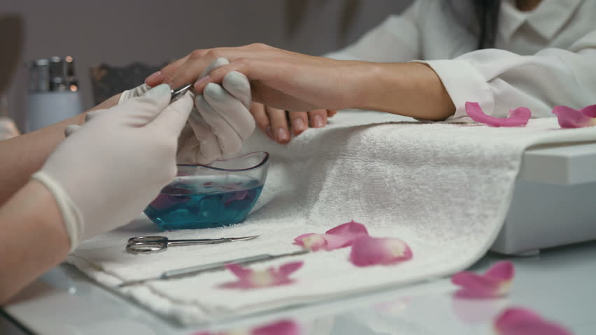 Manicure. Closeup Of Manicurist Hands Removing Cuticle From Female ...