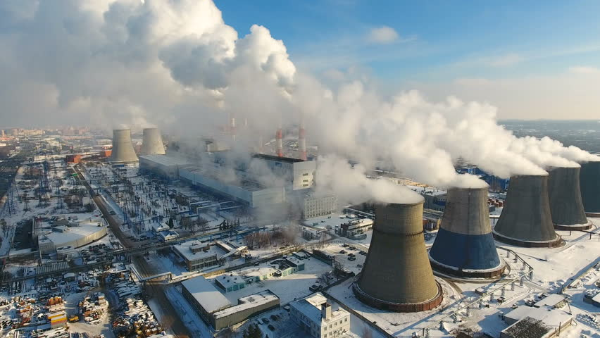 Steam, smoke from pipes at a thermal power station. Aerial.