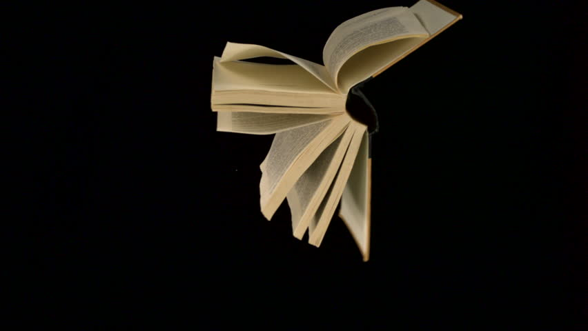 Book flying in the air shooting with high speed camera, phantom flex.   Shutterstock HD Video #2373659