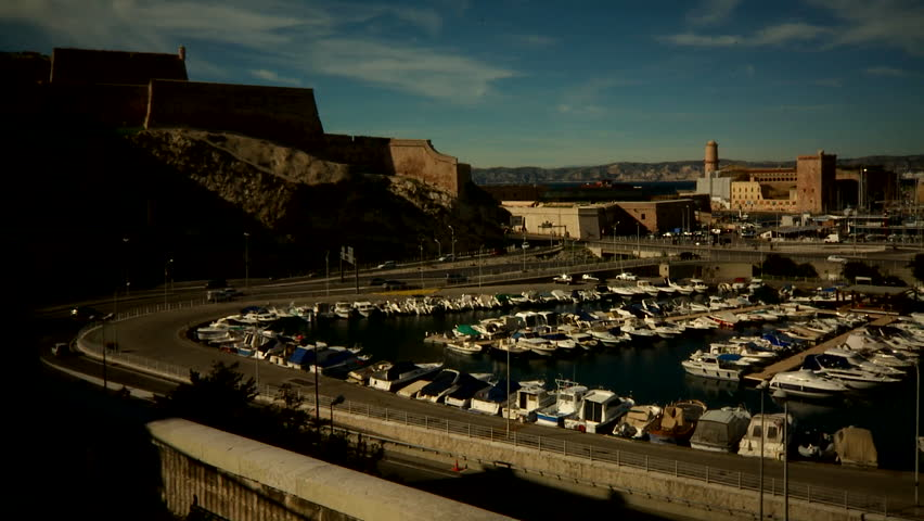 Marseilles, France - CIRCA October 2009: Large view of the city's port with cars circulating.   Shutterstock HD Video #23766019