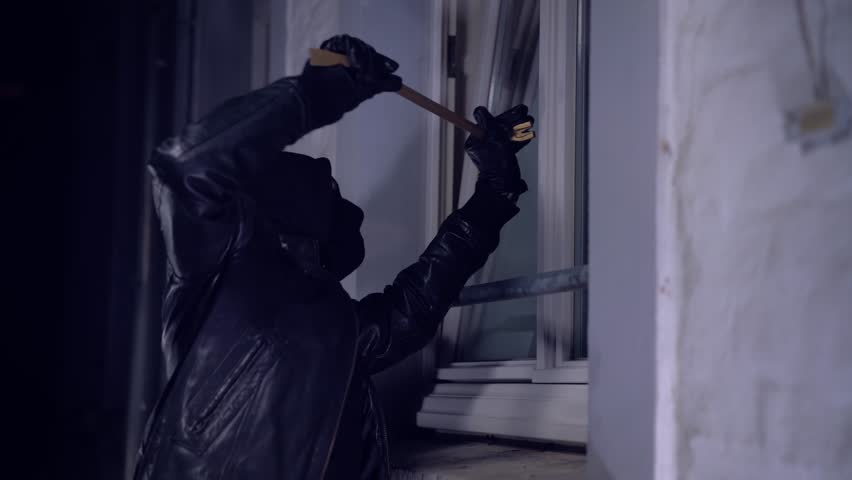 Masked burglars breaking and entering into a victim's home | Shutterstock HD Video #23767951