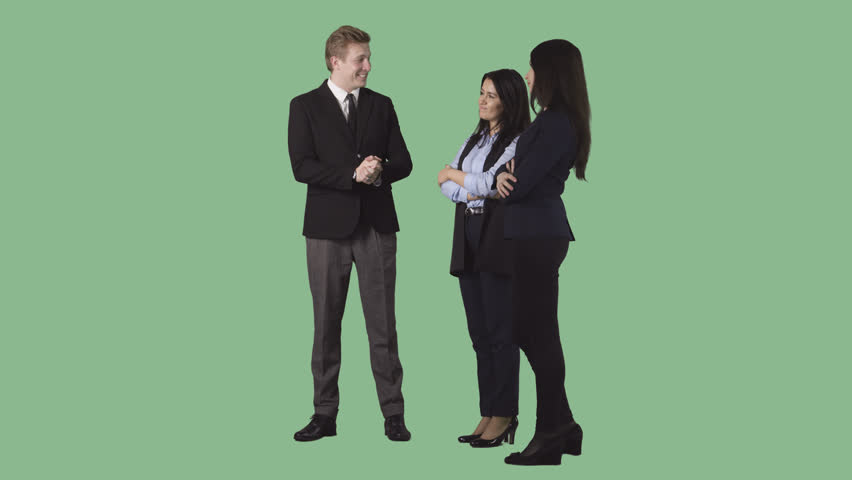 The male in business clothes is standing near two women, showing something, discussing. Clip with alpha channel background