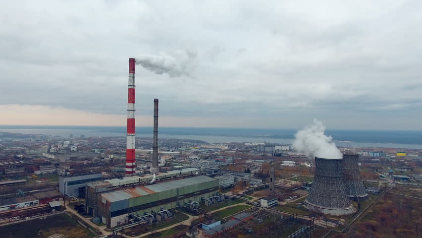 Smoking chimneys, pipes at a power plant. Aerial view made from copter, drone.