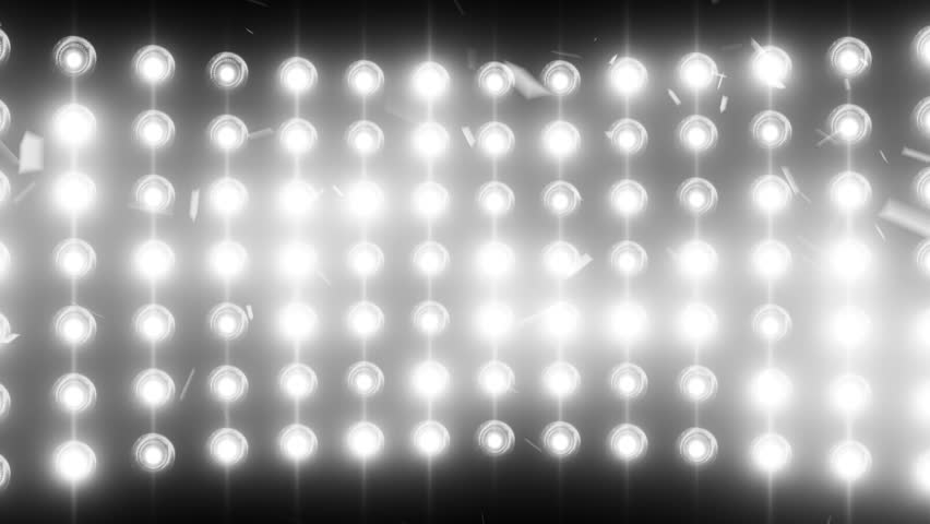 Bright flood lights background with particles and glow. White tint. Seamless loop.