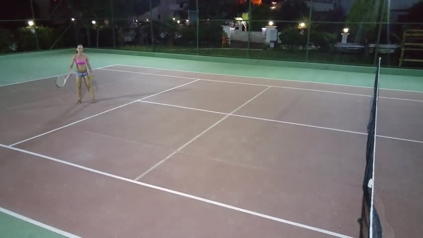 Woman Give Ball On Tennis Court And Miss Back Hit At Night Mobile Phone Video