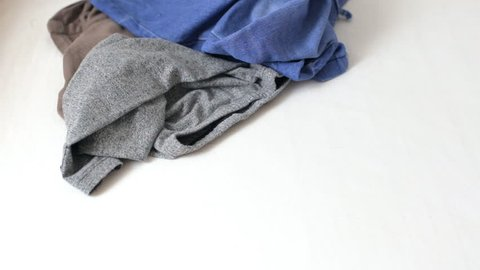 Clothes falling on table