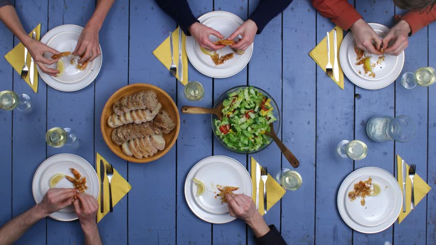 Preparation of grilled fish and fresh vegetable salad. Top view on people eating meal and drinking vine together on rustic mediterranean table setting. Long Stop motion & Timelapse shot. | Shutterstock HD Video #23844526