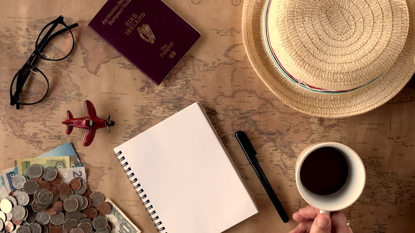 Overhead view of Traveler's accessories, Essential vacation items, Travel concept background, vintage background, love story, selective focus, go to see the world, save money for travel | Shutterstock HD Video #23856931