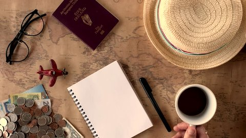 Overhead view of Traveler's accessories, Essential vacation items, Travel concept background, vintage background, love story, selective focus, go to see the world, save money for travel