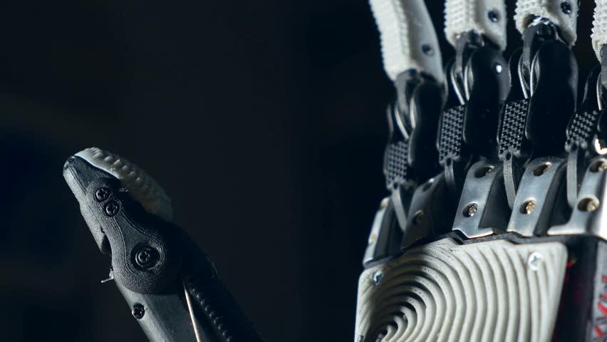 Robotic arm. Futuristic cyborg arm in action.