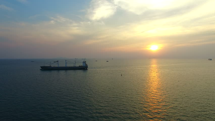 Container ship in blue sea with sun set sky | Shutterstock HD Video #23907490