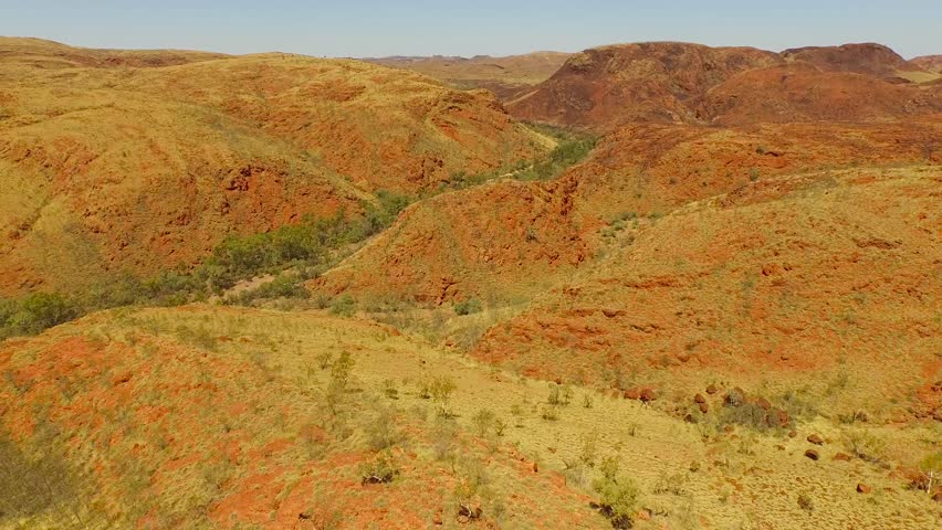 Aerial footage over rugged terrain - The Pilbara region in Western Australia has some of the world's most ancient natural landscapes, dating back two billion years.
