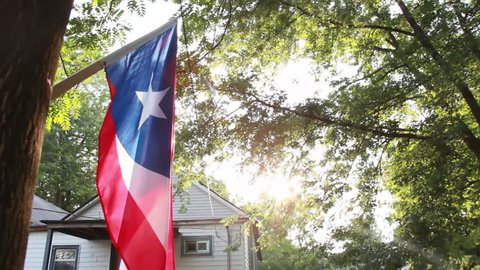 Puerto Rico flag waving in wind low-angle medium shot