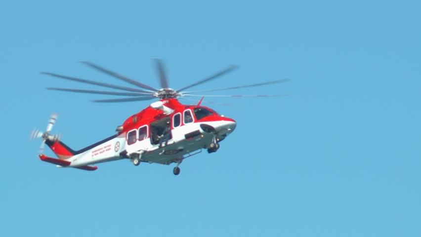 SYDNEY, AUSTRALIA – JUNE 2012: A New South Wales Ambulance Service helicopter flies during a search and rescue mission on June 9, 2012 near La Perouse, Sydney, Australia.