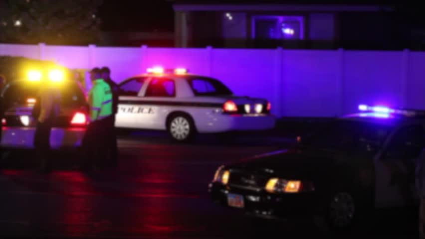 Police Lights Flashing at Night