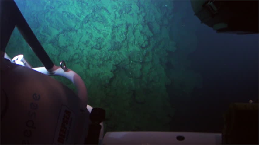 Cocos Island, Costa Rica - 21 September 2015: Cave, reefs, coral, deep sea view from submarine in 300 m depth - Pacific Ocean. Extreme diving. Swim in world of unique wildlife.