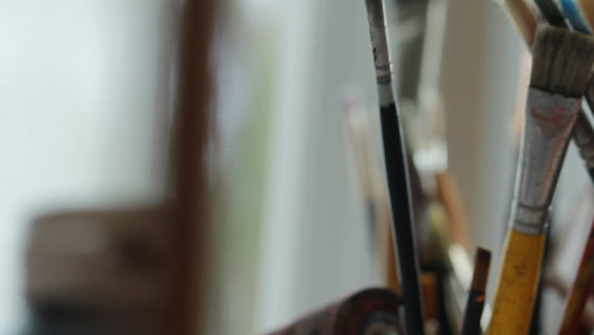 Art studio paint brushes and ink paintings