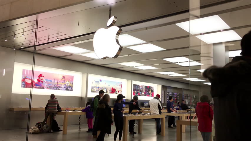 Burnaby, BC, Canada - February 07, 2017 : Motion of people playing iphone inside Apple store with 4k resolution.