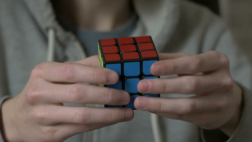 Boys hands solving rubik cube and showing thumb. | Shutterstock HD Video #24126661
