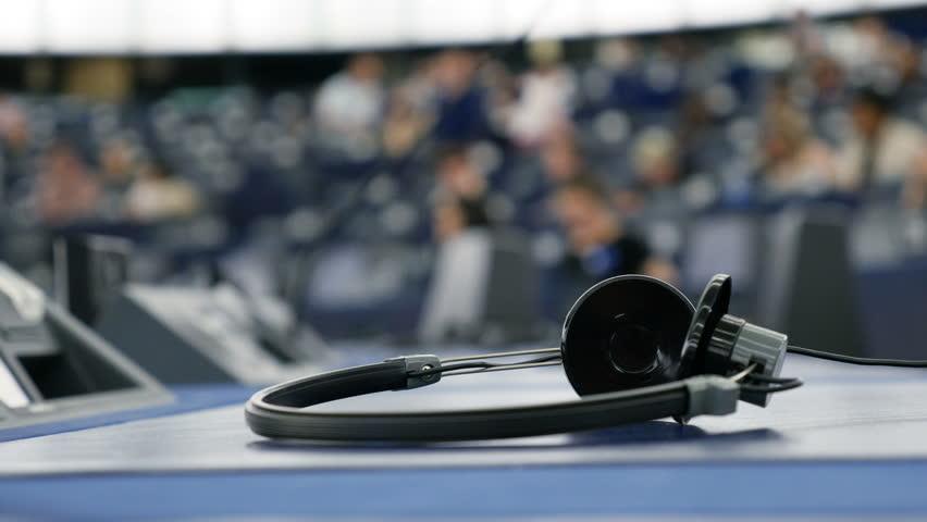 Headphones used for simultaneous translation equipment (simultaneous interpretation equipment or synchronous translation) inside European Parliament debate room  | Shutterstock HD Video #24165616