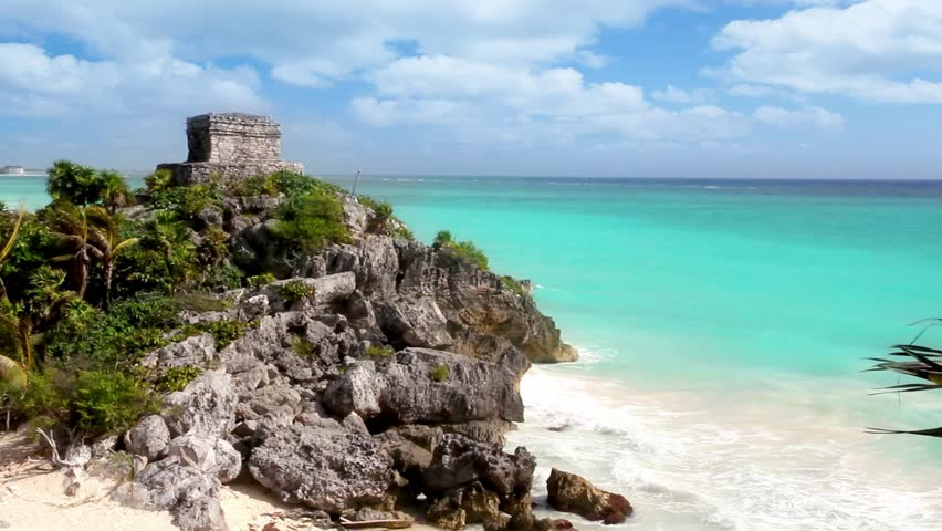 Ancient Tulum Mayan ruins over turquoise Caribbean sea