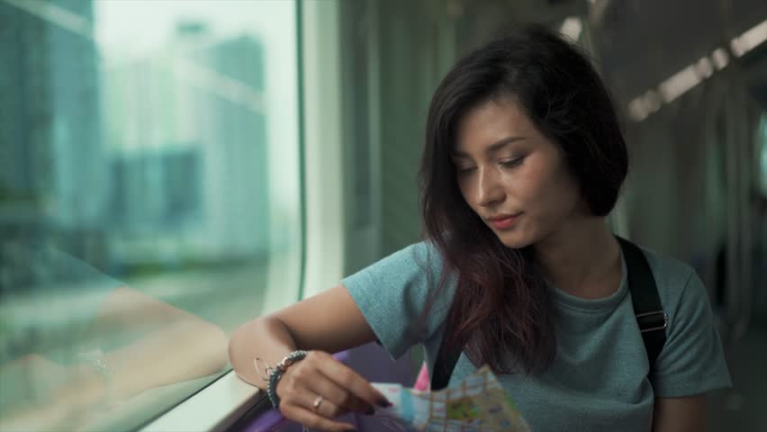 Girl travelling in subway and checking map | Shutterstock HD Video #24187441