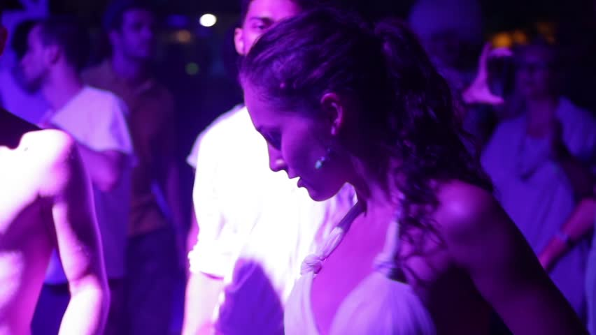 ANAKLIA, GEORGIA - AUGUST 22, 2016. Young girl dancing on the dance floor at party in night club #24208711