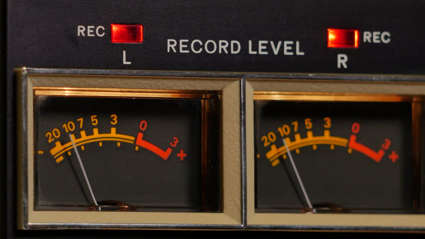 Analog vu meter of a vintage tape recorder machine while recording