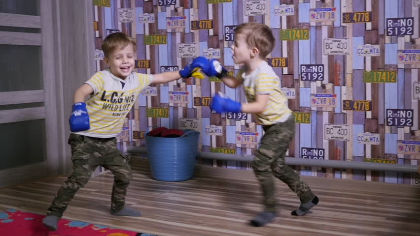 Twin Kids Boys Have Fun Enjoy Playing Fighting With Boxing Gloves At Home